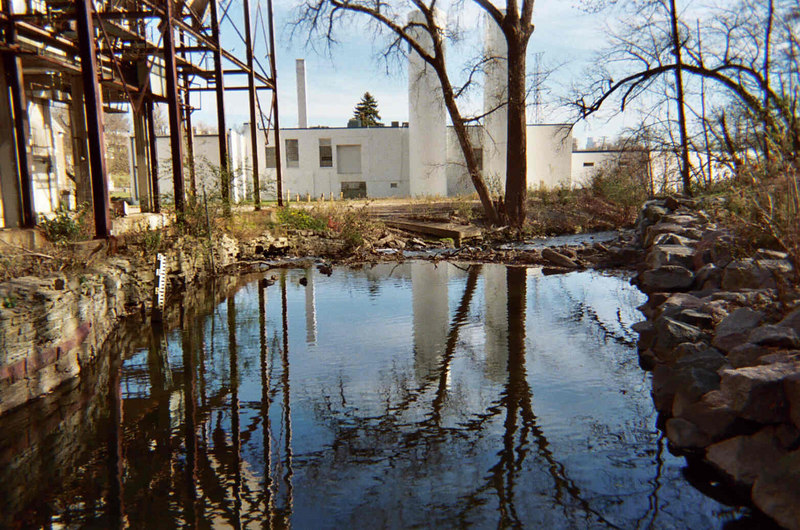 Fruen Mill is on left. Glenwood Inglewood Co. is the white building in the background. The unkayakable dam is just ahead about 60'.<br /> downstream view.<br /> photo by dave stack.