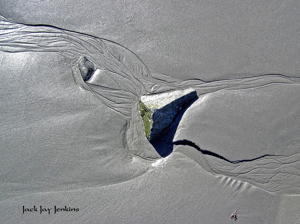 A rock creates its own art.