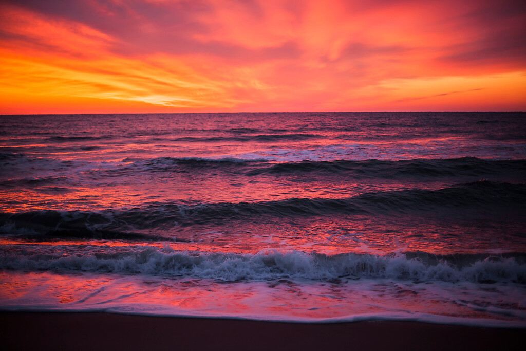 I was fortunate to be up before dawn when, seeing an orange glow on the horizon, dashed out to capture this incredible sunrise.  March 22nd, 2013. Kure Beach, NC.