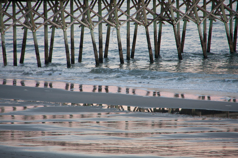 Sunset reflections; pier in Myrtle Beach, South Carolina.
