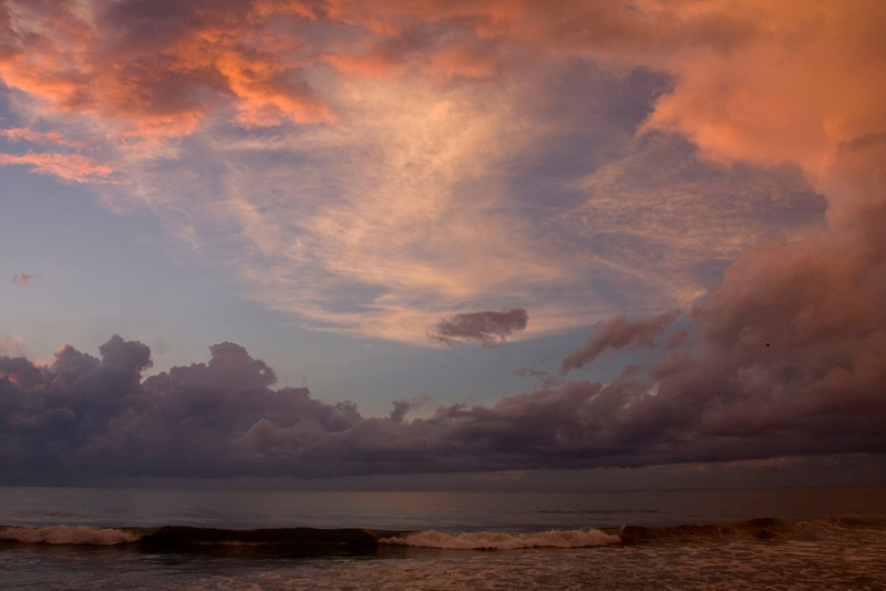 Love, love, love these Maxfield Parrish clouds wrapping around the blue skies while storm clouds whirl around out at sea.  What a show!  Kure Beach, North Carolina.