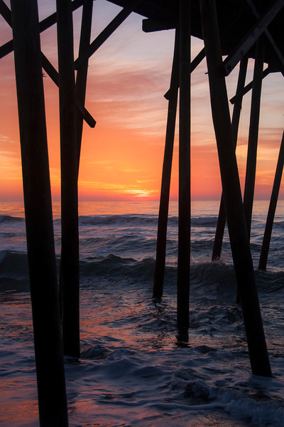 Peeking through the pier at sunrise, North Carolina