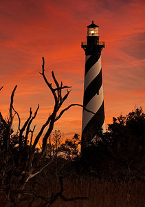 Pre Dawn at Hatteras Light in Buxton, NC. This was a magical time to view the lighthouse as the light was still active in the lighthouse and the sky was just exploding with color just before the sun broke the horizon.