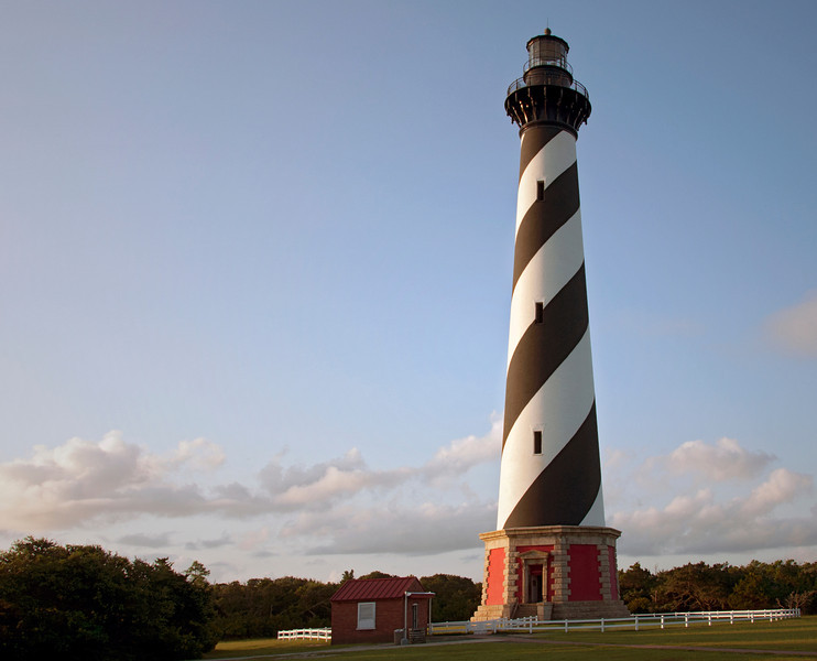 Hatteras Light in Buxton, NC on North Carolina's Outer Banks. This photograph was taken just seconds after the sun hit the horizon.