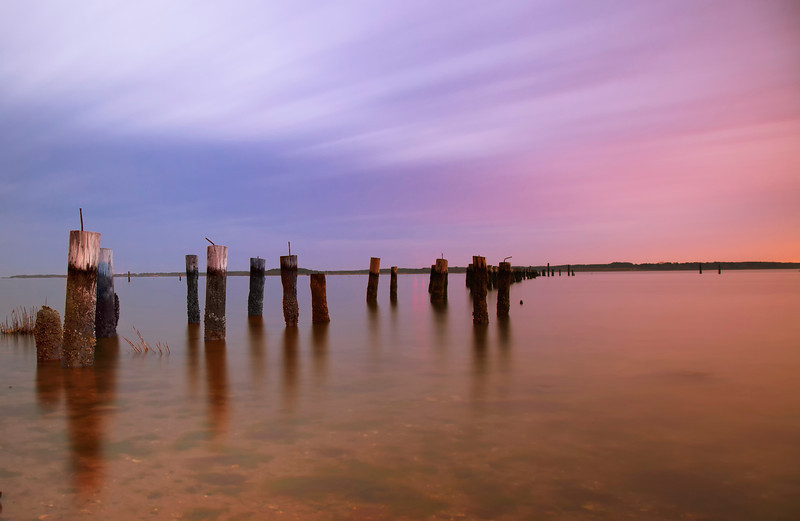 This is a long exposure (several minutes) capture just after sunset at an abandoned pier in Poquoson, Virginia.