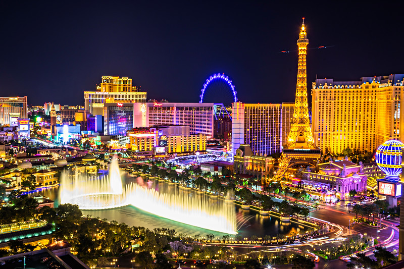 """Bellagio Fountains and Las Vegas Strip at Night"""