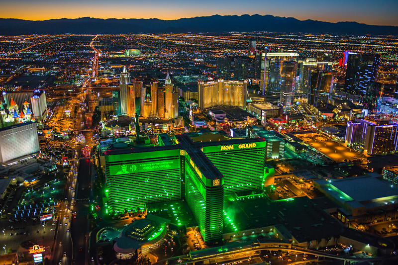 """Aerial View of Las Vegas MGM at Dusk"" I was at the MGM Grand Las Vegas this week for a great work conference but since I hadn't been outside in the 4 days I was there, decided to do an aerial shoot over Las Vegas at dusk! I chartered a R44 helicopter with doors off and we headed out!  The Las Vegas Strip Hotels included here are the Excalibur, The MGM Grand, New York New York, City Center, Aria, Vdara, Cosmopolitan, Rio, Polo Towers and Monte Carlo   Just a perfect time to be flying over the city with the glow of the sunset on the horizon and the lights just starting to glow. This was captured with the Nikon D800, Nikon 24-70 lens @f/2.8, ISO 6400, 1/160th of a second."