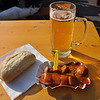 Typical Berlin snack, currywurst, bread and beer.