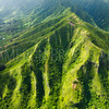 Aerial view of green cliffs on the east side of Oahu, Hawaii.
