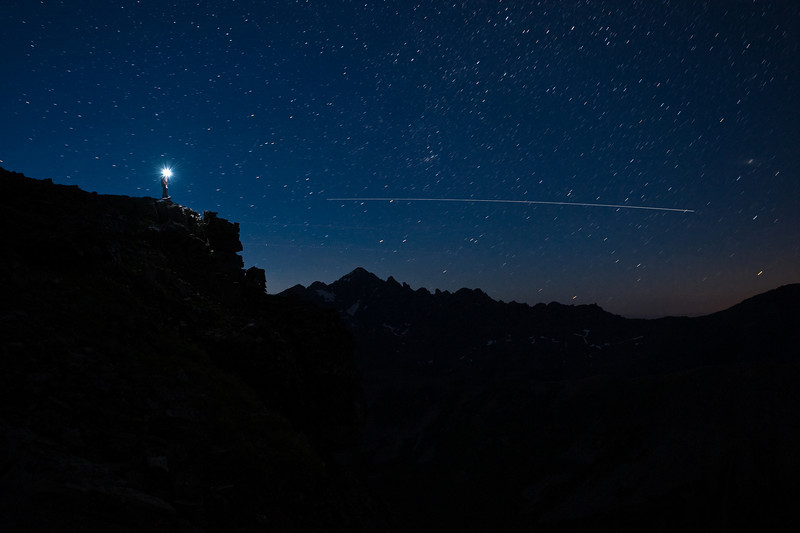 Night sky (with shooting star) with Castle Peak in the background.