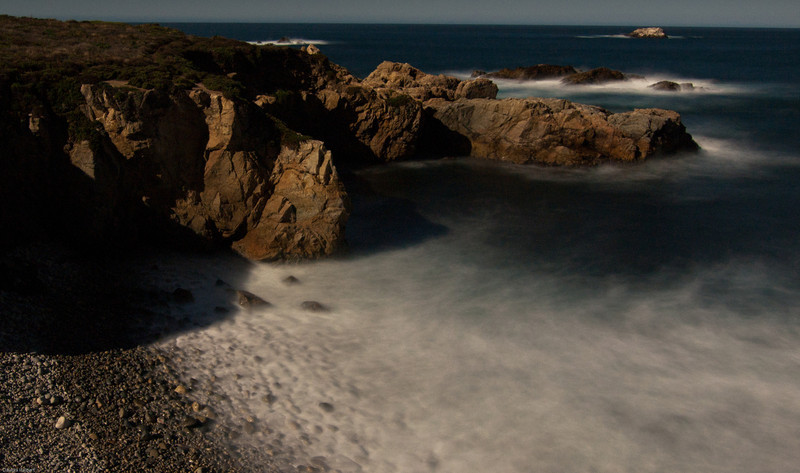 Night photography, Garrapata cliffs. Shadows are cast by the full moon rising in the east. The water looks silky due to the 25 second exposure.
