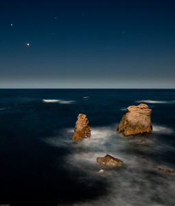 Night photography, Garapata cliffs. The plan was to hike down to the beach to do some long exposures but the tide and waves were so high it would have been unsafe so we stayed up on the cliff. Much safer than being swept out to sea. Two bright stars in the western sky. Venus is the brighter of the two, with Jupiter to its upper left. Shadows are cast by the full moon rising in the east.