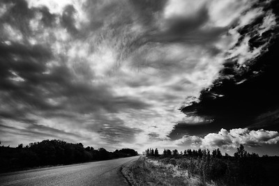 'The Front' - the edge of a storm passes overhead on a lonely rural road. Tornado warnings were abundant yesterday 2 hours north. The classic muggy thunderstorm feel was oppressing.