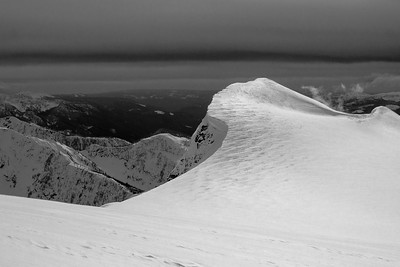 Wind sift - a wave forms a giant cornice near Revelstoke, BC