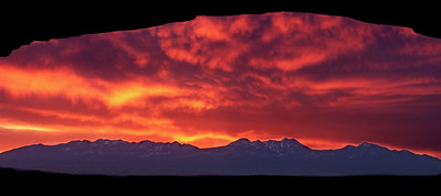 intense predawn glow over the LaSal Mountains, viewed through Mesa Arch, Canyonlands National Park