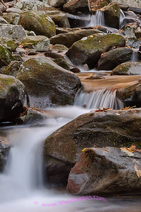 Setting sun reflecting in a cascade, Rainbow falls trail in Great Smokey Mountain National Park.
