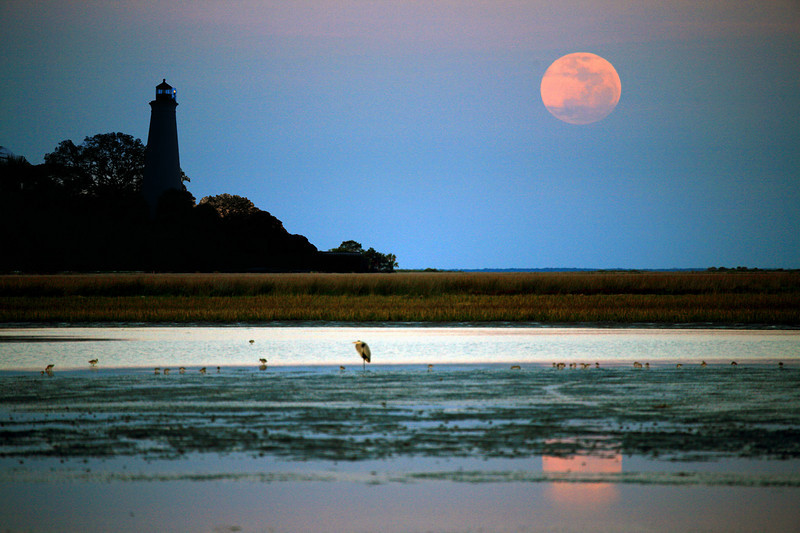 """""""In My Mind"""" was shopped using two photographs, one of the moonrise and another of the lighthouse.  The image actually looks like what you would see standing in about five feet of water at low tide.  I've tried to capture this view with a one shot photo for years without success.  In this case, photography is imitating art."""