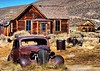 A number of old cars decorate Bodie's landscape.