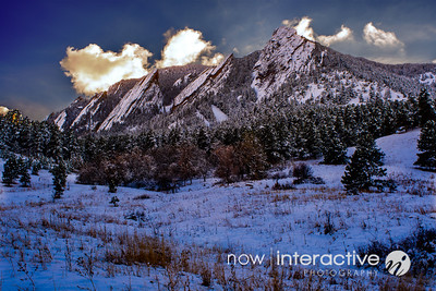 Snowy Flatirons and drifting clouds, Boulder, Colorado