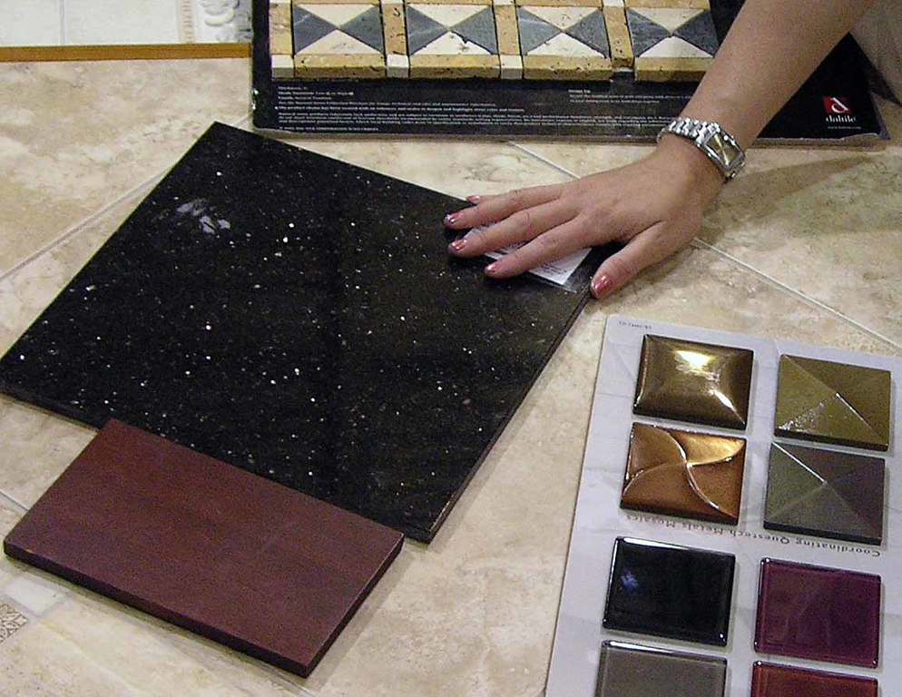 Maureen showing us the samples we picked out - we are going to incorporate some of the metal pieces into the design in the shower