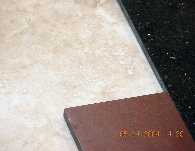 Tile for bathroom with cabinet wood on bottom and possible granite top on right
