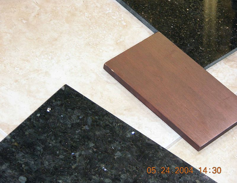 We will probably choose the granite on the bottom for the cabinet tops in the bathroom