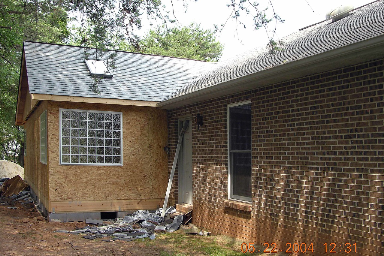 All the shingles are on now - perfect match with the old portion