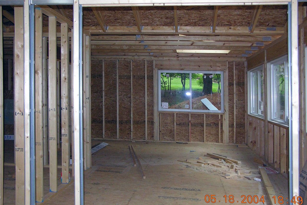 Looking into sewing room, note new door which will be a pocket door and skylight at end