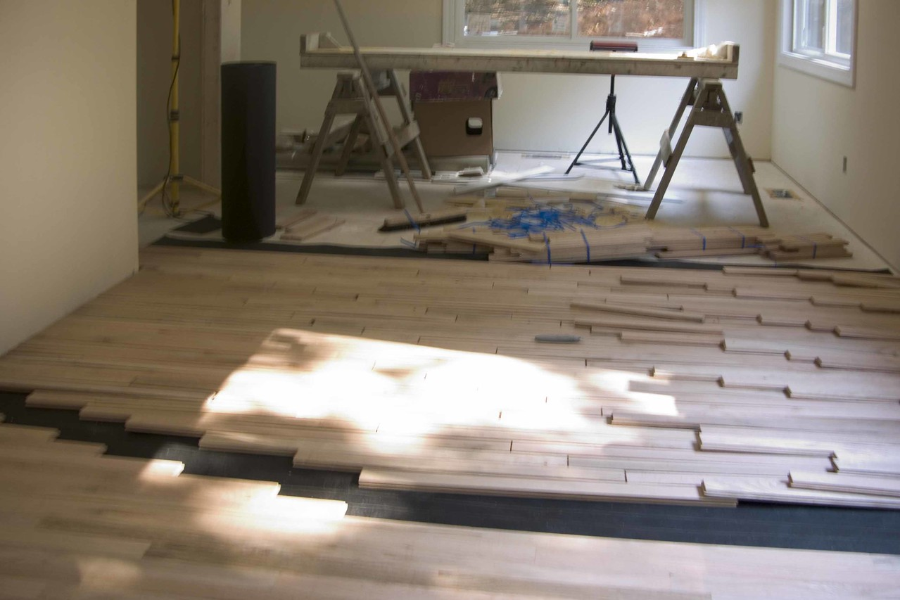 July 13 2004  Lot of work done on the hardwood floors today  Sewing room
