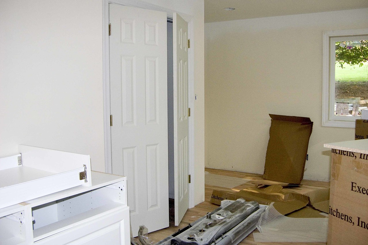 July 19 2004  sewing room - note new cabinet being put together and new door on closet