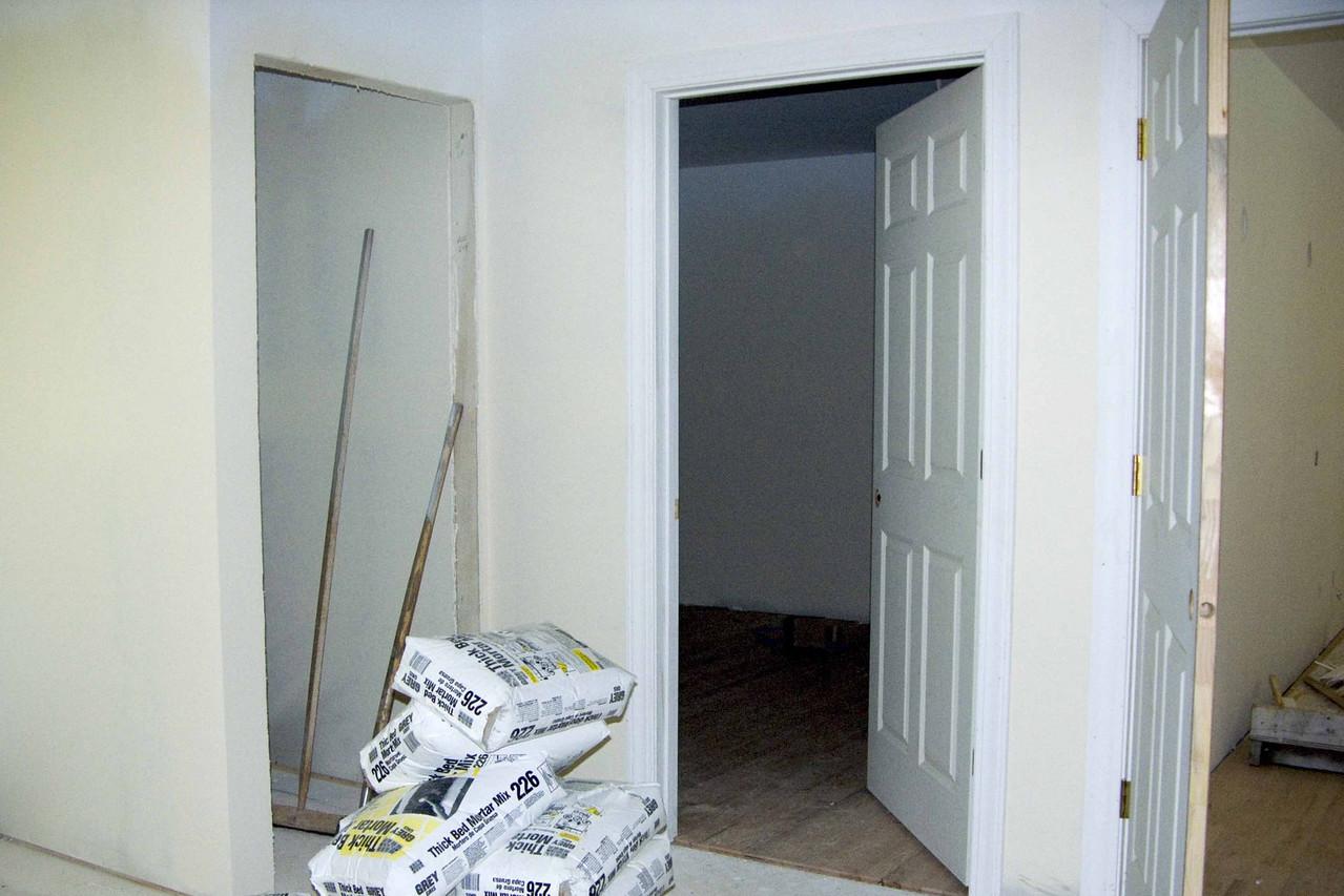 July 19 2004  Toilet door on left, Pat's closet in center, bedroom door on far right