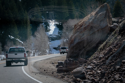 A boulder that slid down the hill toward the road this spring, shot from a moving car, through its windshield, by Wyatt, while I drove..