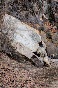 The same boulder, seen from the other side. The tiny people on the right are at the scene of the SUV/rock altercation just up canyon from this slide.