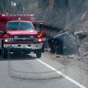 On the way down canyon we came across this SUV that veered off the road and hit a good sized boulder up on the bank. An EMT is attending to the driver. (Wyatt shot this through the windshield as we drove around the scene.)