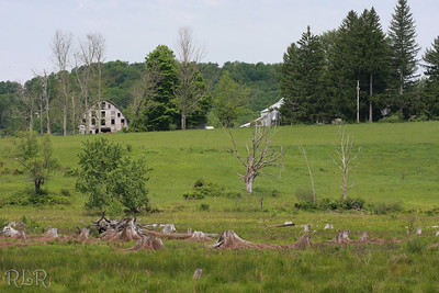 This is looking across Briscoe lake up towards Sherwood Peters  farm. The bus drove up this hill to get to your house.