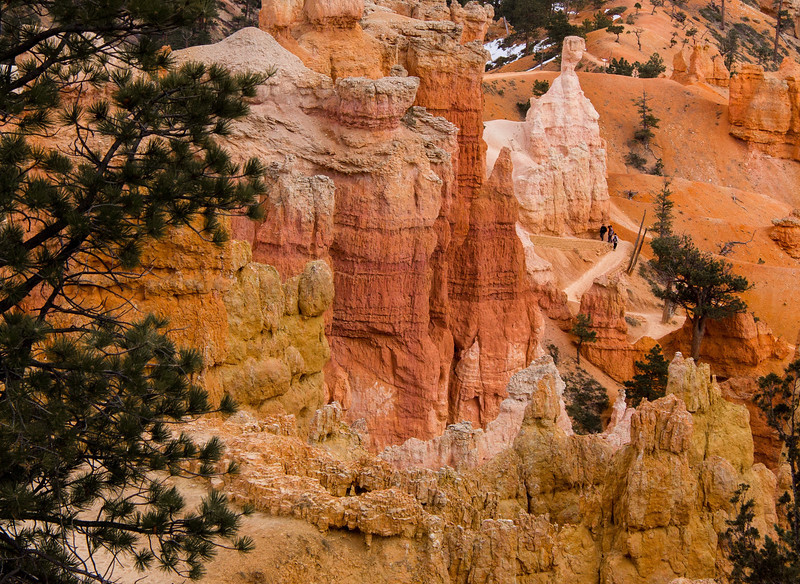 """The cozy but """"group friendly"""" Navaho Trail passes by Thor's Hammer (where the hikers are) and other colorful formations."""