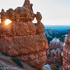 Sunrise peeks thru a hoodo window at Bryce Canyon National park.