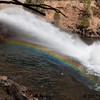 Horizontal rainbow formed by the release waters below button Rock Dam
