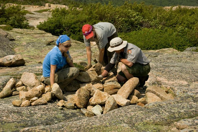 Rangers repairing a cairn-Arcadia NP