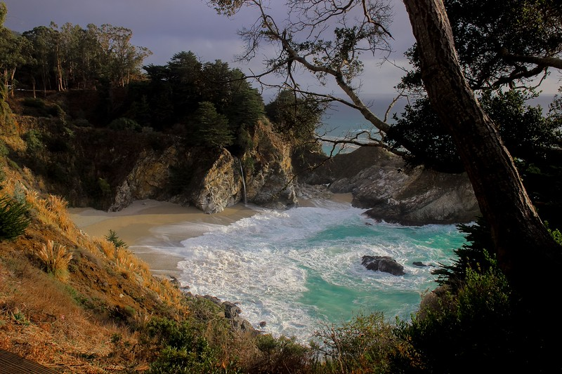 Wide angle of McWay Falls taken from the highway pull over. The State park is off to the left past the highway.