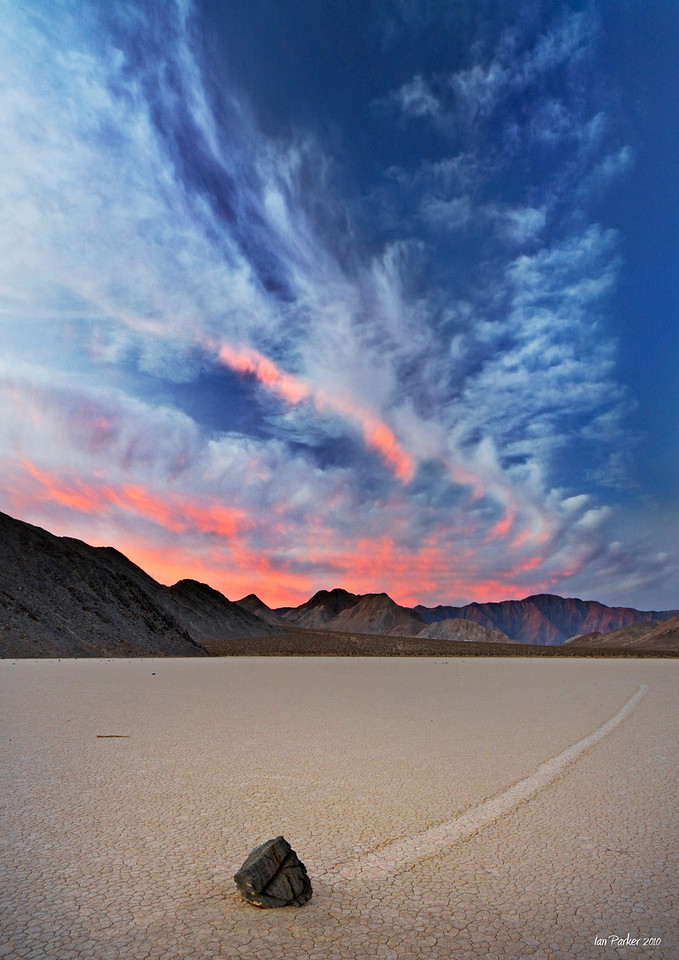 Sunrise over a moving rock; Racetrack Valley, Death Valley National Park
