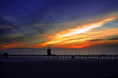 Dramatic Huntington Beach, CA sunset behind the HB pier in silhouette.