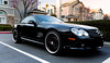 Cool black Mercedes coupe.