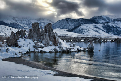 "Mono Lake Tufa State Natural Reserve - The reserve was established to preserve the spectacular ""tufa towers,"" calcium-carbonate spires and knobs formed by interaction of freshwater springs and alkaline lake water. It also protects the lake surface itself as well as the wetlands and other sensitive habitat for the 1 - 2 million birds that feed and rest at Mono Lake each year.  Mono Lake is a majestic body of water covering about 65 square miles. It is an ancient lake, over 1 million years old -- one of the oldest lakes in North America. It has no outlet.  Throughout its long existence, salts and minerals have washed into the lake from Eastern Sierra streams. Freshwater evaporating from the lake each year has left the salts and minerals behind so that the lake is now about 2 1/2 times as salty as the ocean and very alkaline."