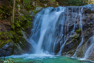A portion of Upper Brandy Creek Falls, Whiskeytown National Recreation Area, is reached by hiking a moderately steep 1.5 mile trail from the end of a park road. Here Brandy Creek plunges 50 feet over a Copley Greenstone bulwark and continues its descent over a series of lesser cascades and falls to Whiskeytown Lake near Redding, CA.