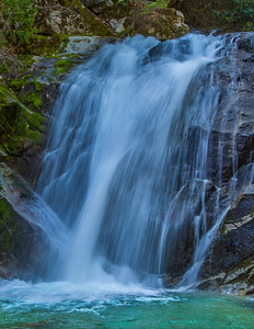 A vertical cropping: A portion of Upper Brandy Creek Falls, Whiskeytown National Recreation Area, is reached by hiking a moderately steep 1.5 mile trail from the end of a park road. Here Brandy Creek plunges 50 feet over a Copley Greenstone bulwark and continues its descent over a series of lesser cascades and falls to Whiskeytown Lake near Redding, CA.