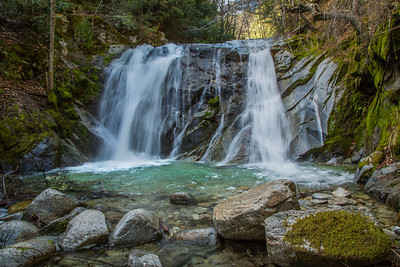 Upper Brandy Creek Falls, Whiskeytown National Recreation Area, is reached by hiking a moderately steep 1.5 mile trail from the end of a park road. Here Brandy Creek plunges 50 feet over a Copley Greenstone bulwark and continues its descent over a series of lesser cascades and falls to Whiskeytown Lake near Redding, CA.