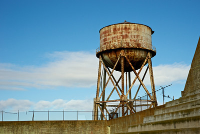 The rusted bulk of the Alcatraz Jail water tower.
