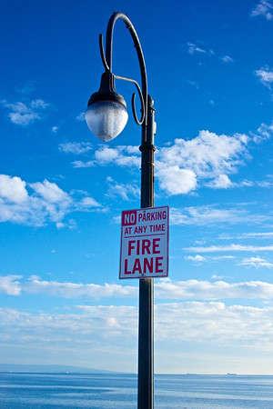 Light pole on Santa Monica Pier holds a No Parking sign.