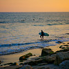 Surfer Walks into Pacific